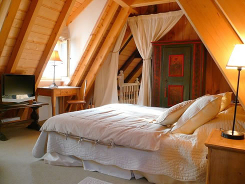 Our vacation rental apartments (gites) in Riquewihr are very special places to stay: a perfect combination of Alsatian tradition and modern comfort. Here you see the master bedroom of the Dove's Nest, a spacious self catering house.